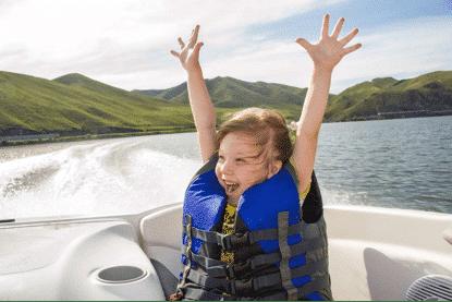 Happy kid on boat