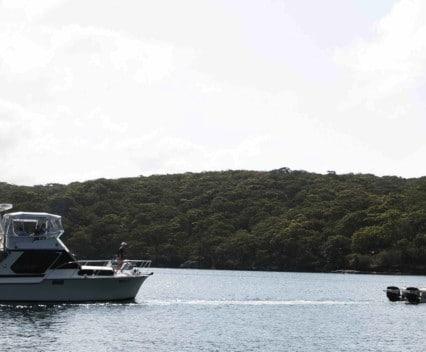 boat broken down being towed