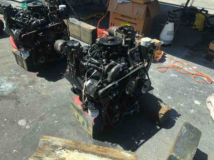 Two Mercruiser V6 engines on hard stand